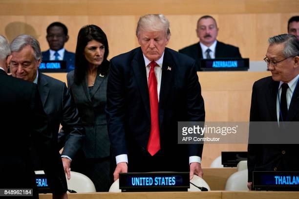 US Ambassador to the UN Nikki Haley and US President Donald Trump take their seats before a meeting on United Nations Reform at the UN headquarters...
