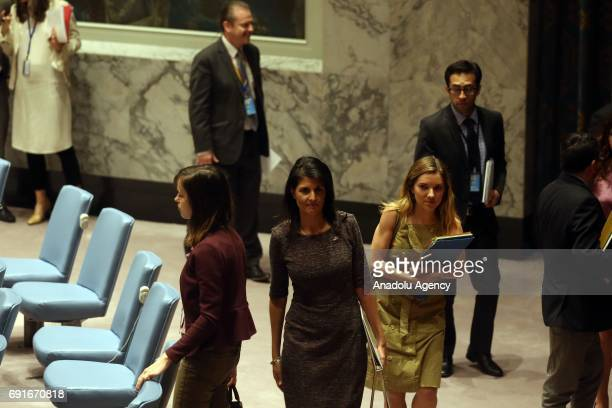 Ambassador to the UN Nikki Haley walks out of UN Security Council meeting following a unanimous adoption by the Council to expand its North Korea...
