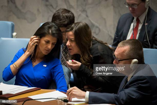 S Ambassador to the United Nations Nikki Haley confers with aides while she chairs a meeting of the United Nations Security Council at UN...