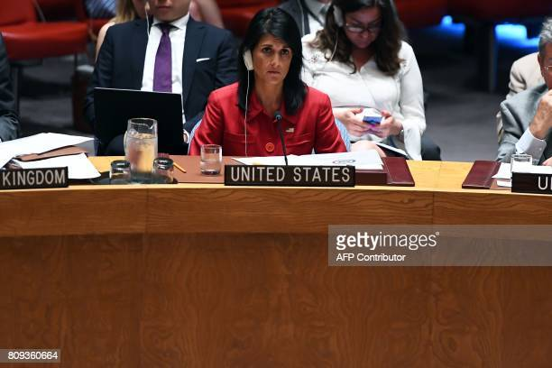 US Ambassador to the United Nations Nikki Haley listens as Russia's deputy UN ambassador Vladimir Safronkov speaks during a Security Council meeting...