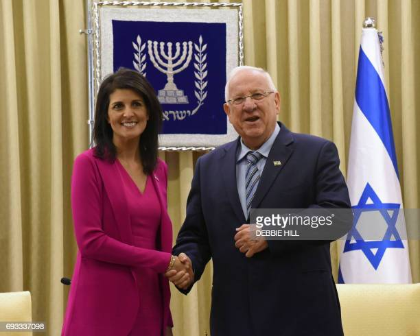 US ambassador to the United Nations Nikki Haley shakes hands with Israeli President Reuven Rivlin in his official residence in Jerusalem on June 7...