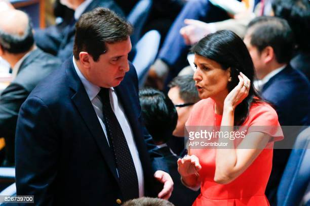US Ambassador to the United Nations Nikki Haley speaks with Vladimir Safronkov Russia's Deputy Ambassador to the United Nations before voting on a...