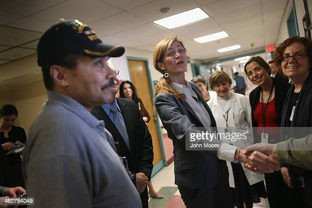 S Ambassador to the United Nations Samantha Power greets military veterans at the Veterans Administration hospital in on January 15 2014 in New York...