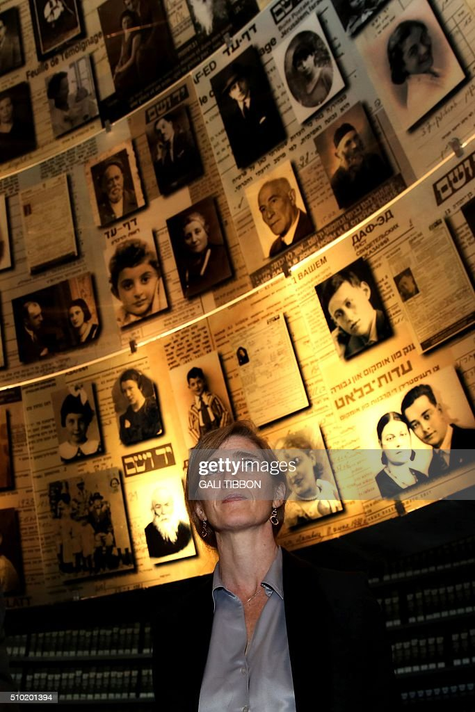 US Ambassador to the United Nations Samantha Power looks at pictures of Jewish Holocaust victims at the Hall of Names on February 14, 2016 during her visit to the Yad Vashem Holocaust Memorial museum in Jerusalem commemorating the six million Jews killed by the German Nazis and their collaborators during World War II. / AFP / Gali Tibbon