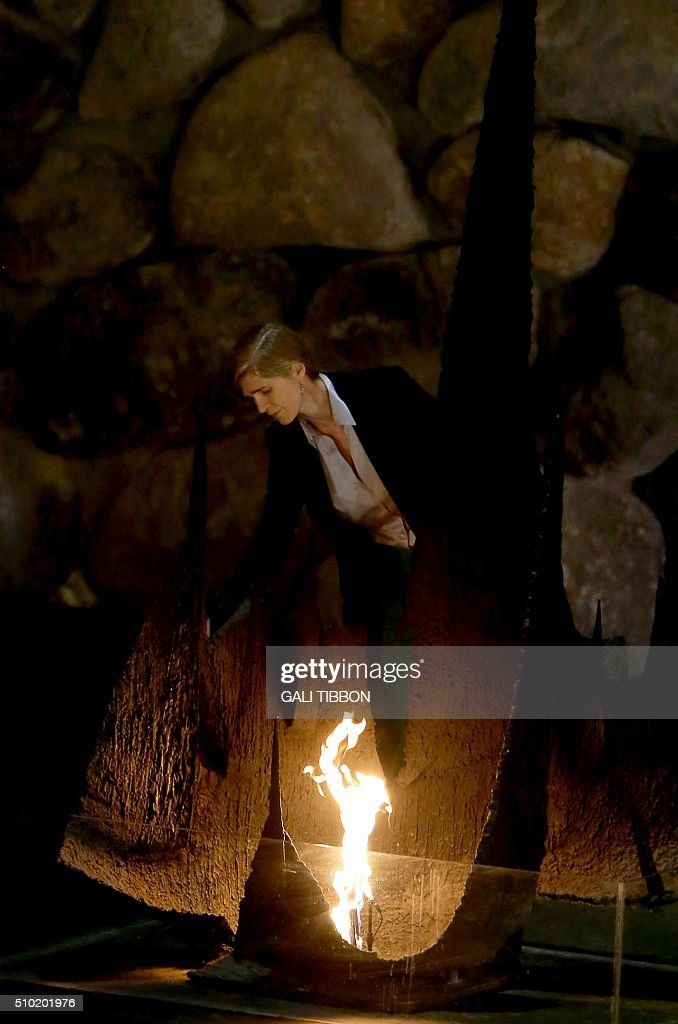 US Ambassador to the United Nations Samantha Power rekindles the eternal flame at the Hall of Remembrance on February 14, 2016 during her visit to the Yad Vashem Holocaust Memorial museum in Jerusalem commemorating the six million Jews killed by the German Nazis and their collaborators during World War II. / AFP / Gali Tibbon