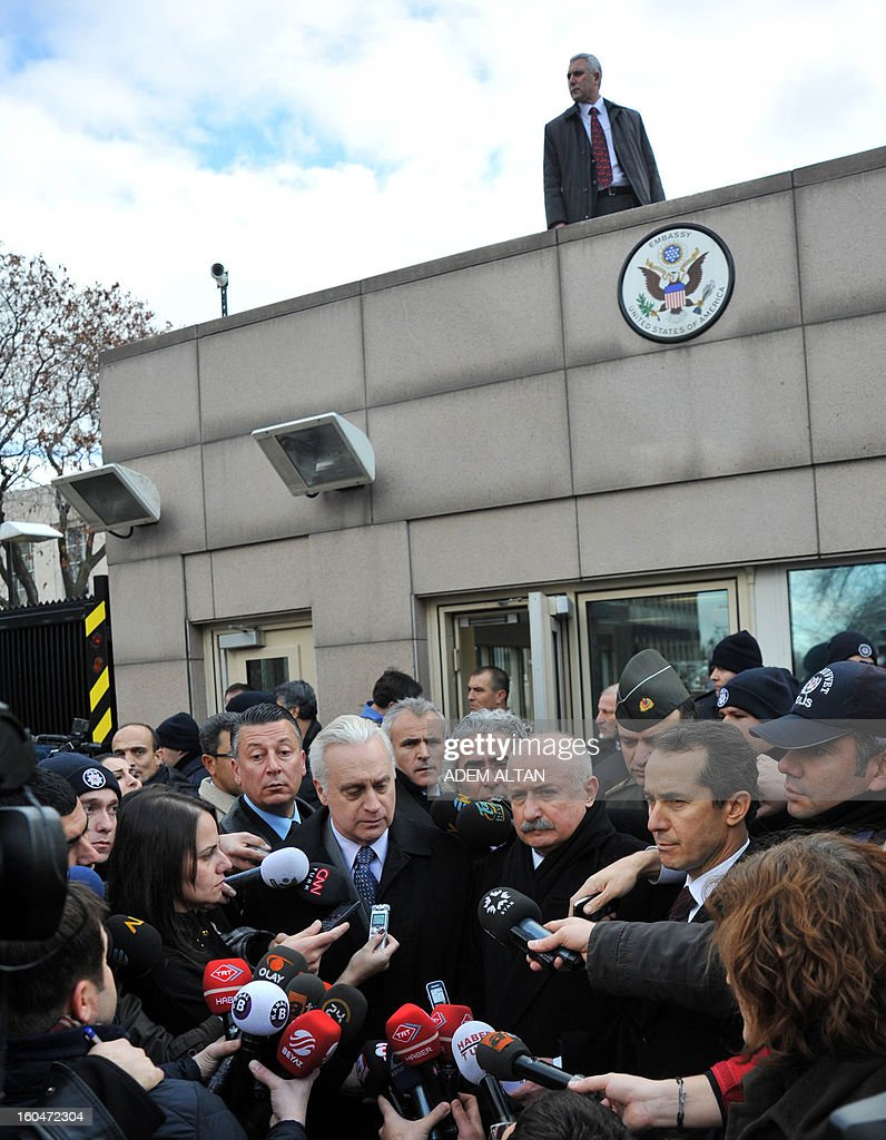 US ambassador to Turkey Francis J. Ricciardone (C, L) and provincial governor Alaaddin Yuksel (C, R) give a press point on February 1, 2013 at the site of a blast outside the US Embassy in Ankara. A Turkish security guard was killed and several other people wounded in a suicide bombing at the entrance to the highly-fortified US embassy in Ankara on February 1, officials said. The force of the blast damaged nearby buildings in the upmarket Cankaya neighbourhood of the capital where many other state institutions and embassies are also located.