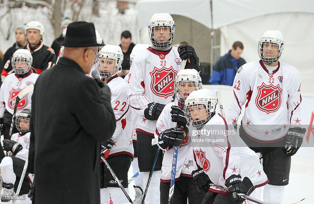 Ambassador Willie O'Ree speaks to underprivileged youth at an outside rink at the 2012 NHL All-Star Game - H.E.R.O.S. Community Program Launch at Rideau Hall on January 28, 2012 in Ottawa, Ontario, Canada.