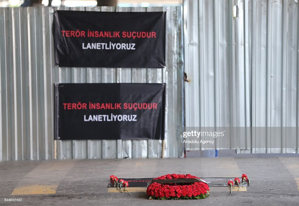 Ambassadors and EU representatives of 22 countries leave carnation during a commemorative ceremony held for the victims of the Istanbul Airport terror attack outside the International departure terminal in Istanbul, Turkey on July 1, 2016.