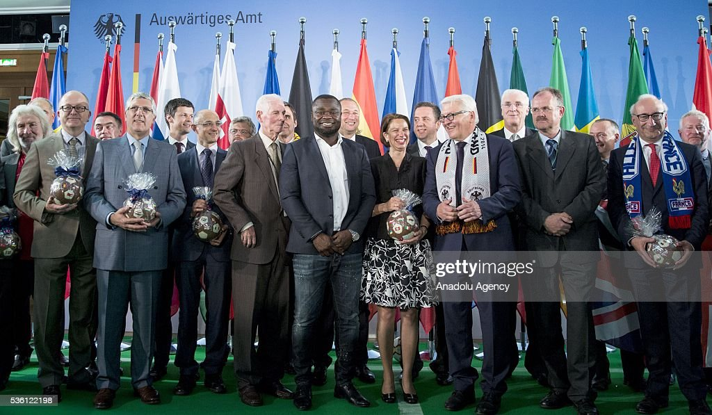 Ambassadors pose for a photo during an event at the foreign ministry in Berlin on May 31, 2016, ahead of the UEFA Euro 2016 taking place in France next month.
