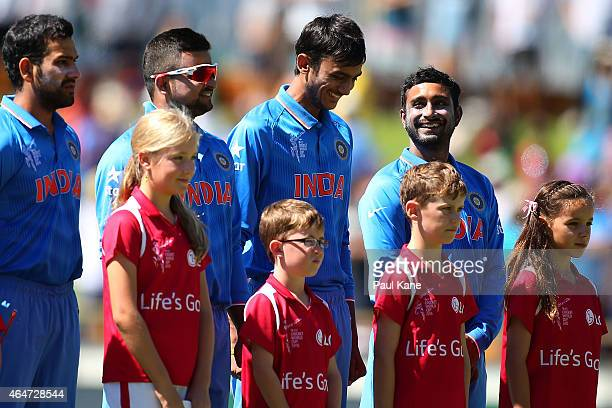 Ambati Rayudu of India smiles during the playing of the national anthems during the 2015 ICC Cricket World Cup match between India and the United...
