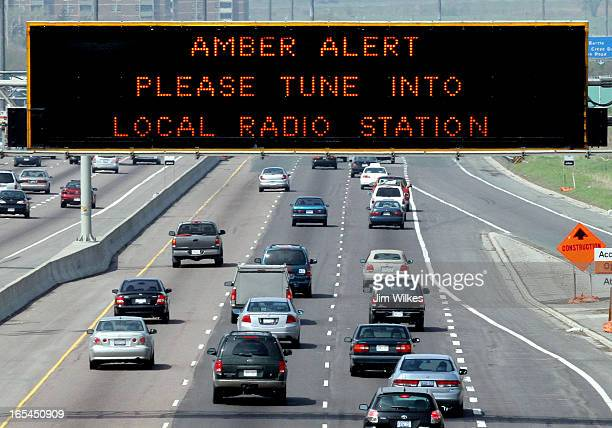 AMBER 1 / 05/14/05 Amber Alert is displayed on sign over westbound Highway 401 near Keele St Police are hunting a man suspected of killing his...