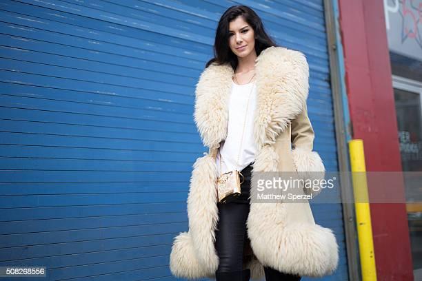 Amber Alexandria is seen at Pier 59 Studios wearing vintage London fur coat Alexander Wang shirt vintage bag and Rock Republic pants during New York...