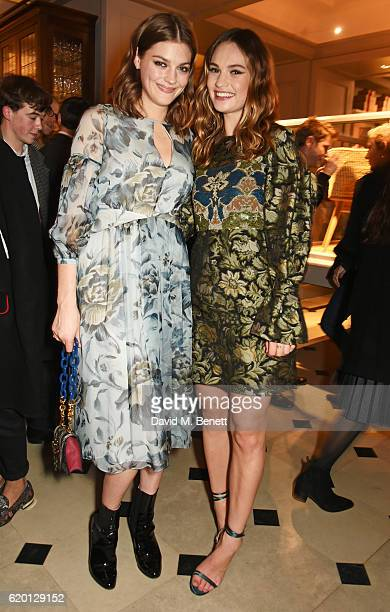 Amber Anderson and Lily James wearing Burberry attend an event to celebrate 'The Tale of Thomas Burberry' at Burberry's all day cafe Thomas's on...