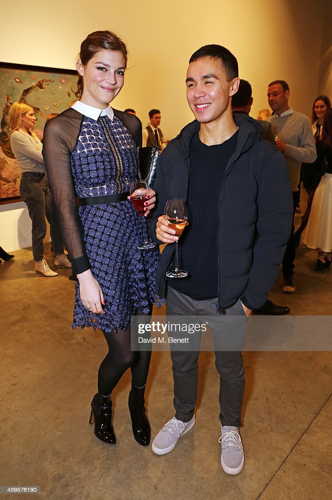 Amber Anderson and Pim Stones attend a dinner to celebrate SelfPortrait Studio's 1st Anniversary with Han Chong at Victoria Miro Gallery on November...