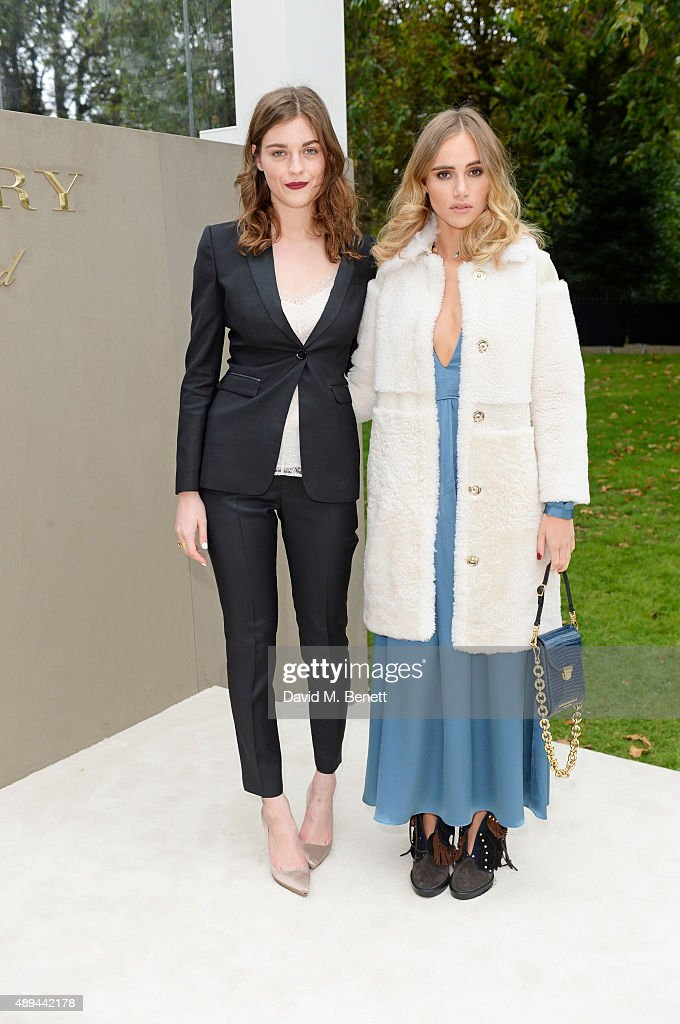 Amber Anderson and Suki Waterhouse arrive at Burberry Womenswear Spring/Summer 2016 show during London Fashion Week at Kensington Gardens on...
