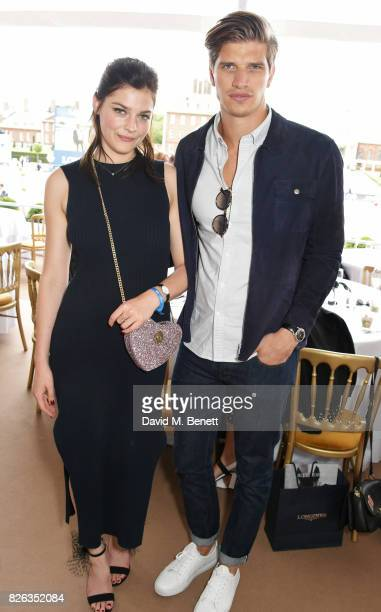 Amber Anderson and Toby HuntingtonWhiteley attend the Longines hospitality lounge at the Global Champions Tour at the Royal Hospital Chelsea on...