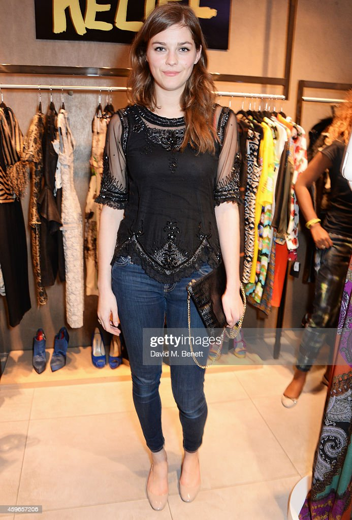 Amber Anderson attends as Naomi Campbell launches the Fashion For Relief PopUp at The Village Westfield London on November 27 2014 in London England...