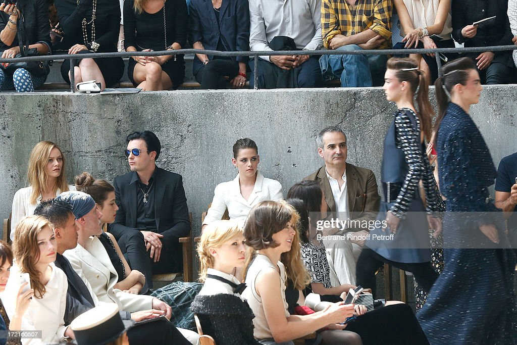 Amber Anderson, Vanessa Paradis, Michael Pitt , Kristen Stewart, Olivier Assayas and Milla Jovovich attend the Chanel show as part of Paris Fashion Week Haute-Couture Fall/Winter 2013-2014 at Grand Palais on July 2, 2013 in Paris, France.