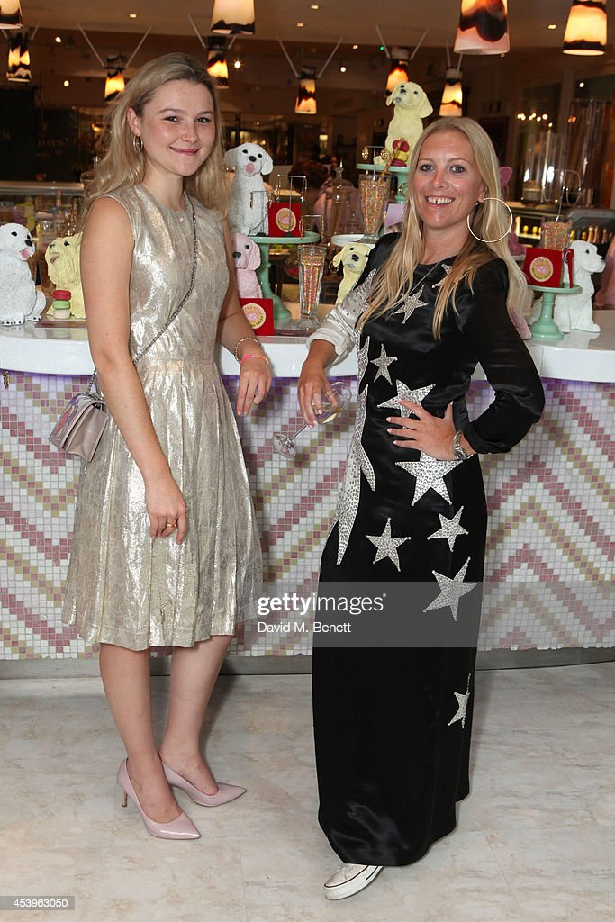 <a gi-track='captionPersonalityLinkClicked' href=/galleries/search?phrase=Amber+Atherton&family=editorial&specificpeople=7192882 ng-click='$event.stopPropagation()'>Amber Atherton</a> and Victoria Young attend the launch of Victoria Young x MYFLASHTRASH, a jewellery collaboration between <a gi-track='captionPersonalityLinkClicked' href=/galleries/search?phrase=Amber+Atherton&family=editorial&specificpeople=7192882 ng-click='$event.stopPropagation()'>Amber Atherton</a> and Victoria Young, at Fortnum & Mason's newly refurbished The Parlour restaurant on August 22, 2014 in London, England.