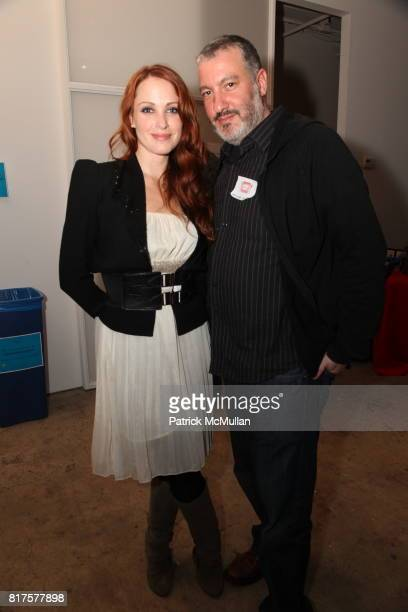 Amber De Vos and Spencer Tunick attend SLIDE LUCK Auction Fundraiser Hosted By Patrick McMullan DJ Spooky at Sandbox Studio on December 8 2010 in New...