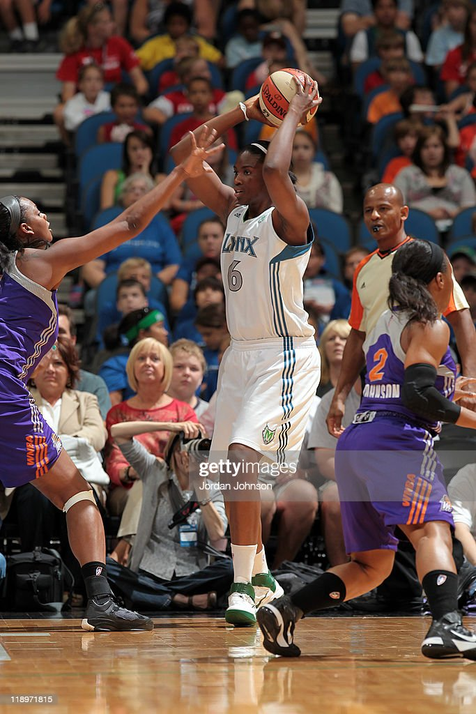 <a gi-track='captionPersonalityLinkClicked' href=/galleries/search?phrase=Amber+Harris&family=editorial&specificpeople=2225907 ng-click='$event.stopPropagation()'>Amber Harris</a> #6 of the Minnesota Lynx looks to move the ball against <a gi-track='captionPersonalityLinkClicked' href=/galleries/search?phrase=Kara+Braxton&family=editorial&specificpeople=226695 ng-click='$event.stopPropagation()'>Kara Braxton</a> #45 of the Phoenix Mercury during the game on July 13, 2011 at the Target Center in Minneapolis, Minnesota.