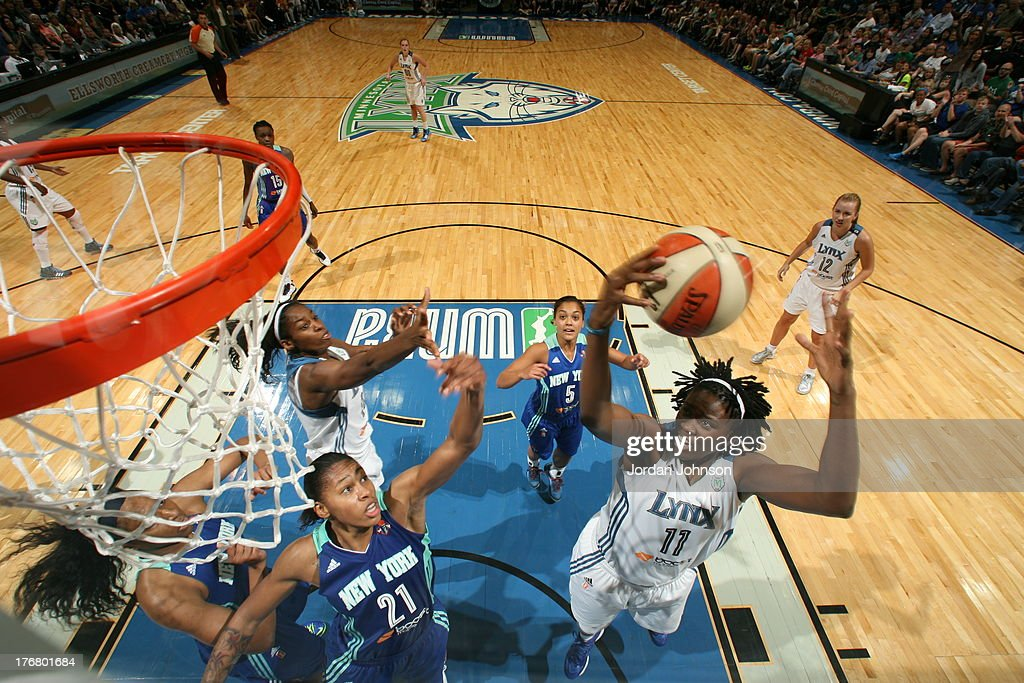 <a gi-track='captionPersonalityLinkClicked' href=/galleries/search?phrase=Amber+Harris&family=editorial&specificpeople=2225907 ng-click='$event.stopPropagation()'>Amber Harris</a> #11 of the Minnesota Lynx rebounds against Alex Montgomery #21 of the New York Liberty during the WNBA game on August 18, 2013 at Target Center in Minneapolis, Minnesota.
