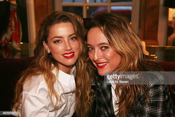 Amber Heard Alice Temperley attends a photocall to unveil the new 'Alice In Wonderland' themed window at Temperley London on February 20 2015 in...