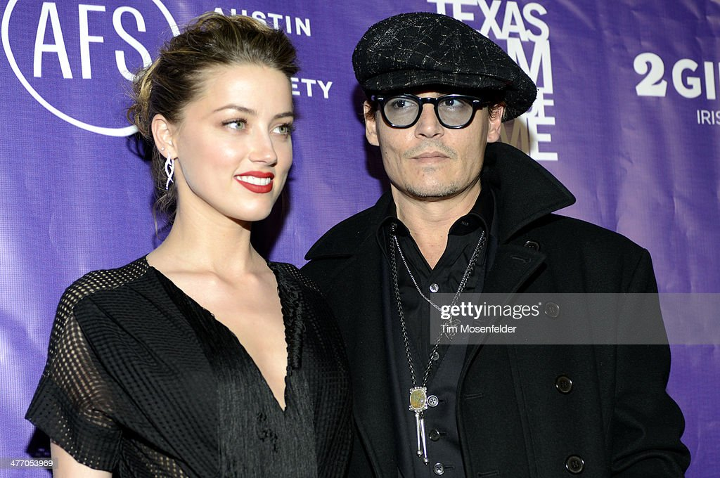<a gi-track='captionPersonalityLinkClicked' href=/galleries/search?phrase=Amber+Heard&family=editorial&specificpeople=2210577 ng-click='$event.stopPropagation()'>Amber Heard</a> (L) and <a gi-track='captionPersonalityLinkClicked' href=/galleries/search?phrase=Johnny+Depp&family=editorial&specificpeople=202150 ng-click='$event.stopPropagation()'>Johnny Depp</a> arrive at the 2014 Texas Film Awards presented by the Austin Film Society at Austin Studios on March 6, 2014 in Austin, Texas.