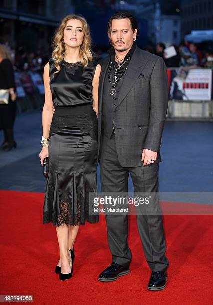 Amber Heard and Johnny Depp attend a screening of 'Black Mass' during the BFI London Film Festival at Odeon Leicester Square on October 11 2015 in...