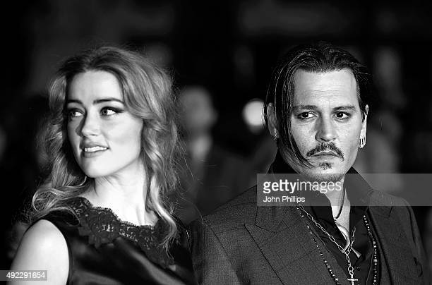 Amber Heard and Johnny Depp attend the 'Black Mass' Virgin Atlantic Gala screening during the BFI London Film Festival at Odeon Leicester Square on...