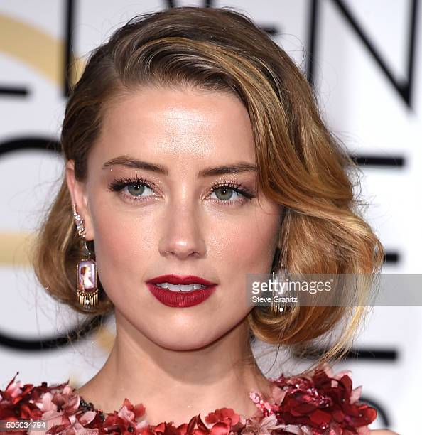 Amber Heard arrives at the 73rd Annual Golden Globe Awards at The Beverly Hilton Hotel on January 10 2016 in Beverly Hills California