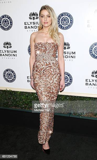Amber Heard arrives at The Art of Elysium celebrating the 10th Anniversary held at Red Studios on January 7 2017 in Los Angeles California
