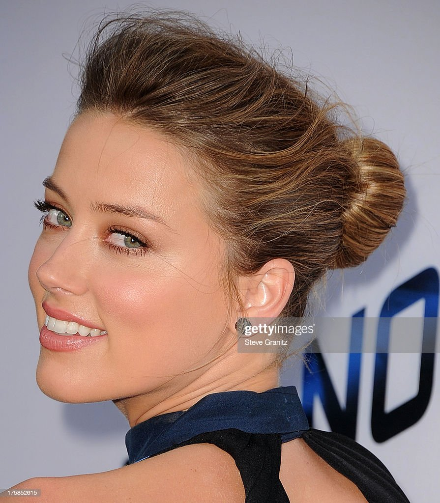 <a gi-track='captionPersonalityLinkClicked' href=/galleries/search?phrase=Amber+Heard&family=editorial&specificpeople=2210577 ng-click='$event.stopPropagation()'>Amber Heard</a> arrives at the 'Paranoia' - Los Angeles Premiere at DGA Theater on August 8, 2013 in Los Angeles, California.
