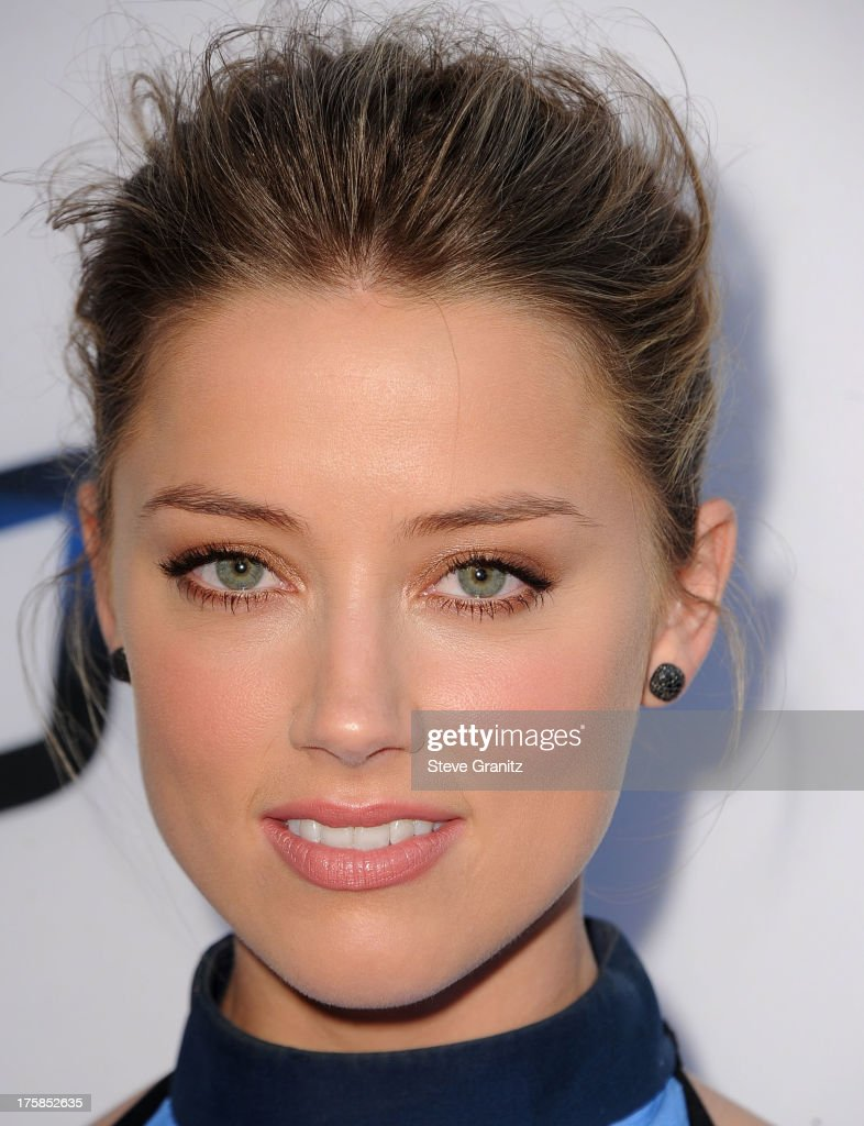 Amber Heard arrives at the 'Paranoia' - Los Angeles Premiere at DGA Theater on August 8, 2013 in Los Angeles, California.