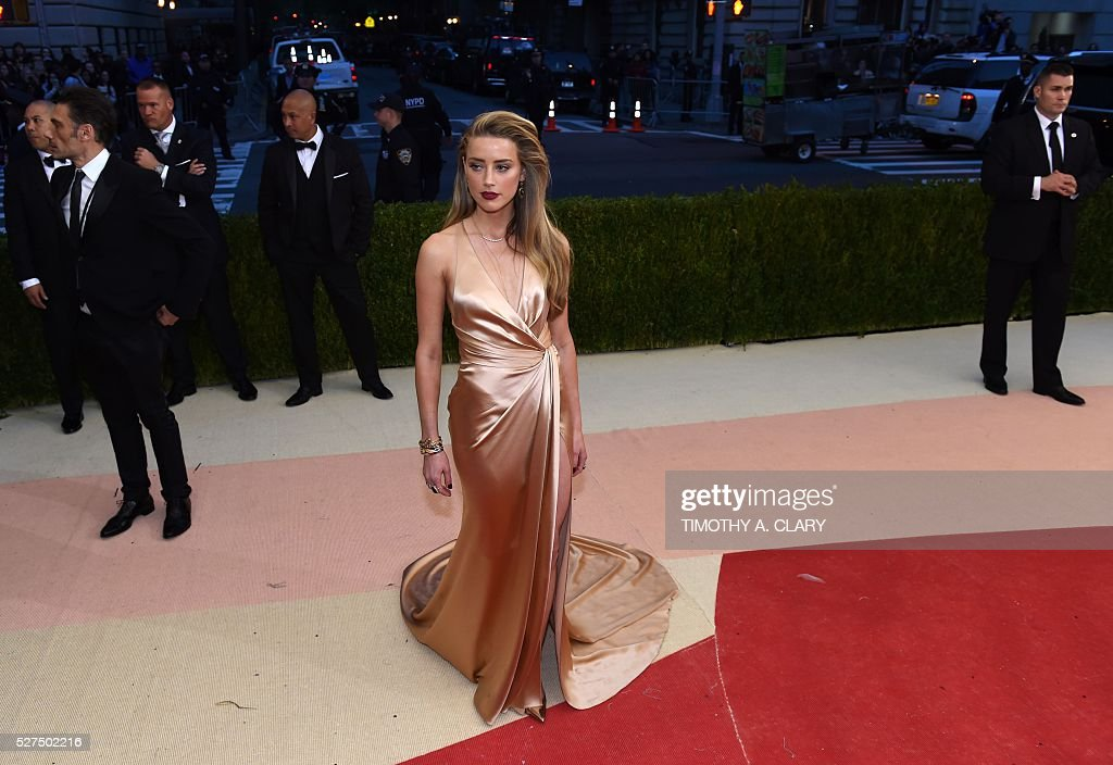 Amber Heard arrives for the Costume Institute Benefit at The Metropolitan Museum of Art May 2, 2016 in New York. / AFP / TIMOTHY
