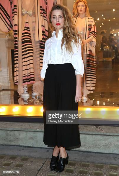 Amber Heard attends a photocall to unveil the new 'Alice In Wonderland' themed window at on February 20 2015 in London England