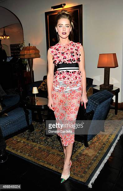 Amber Heard attends MAC and Vogue Celebrate Giambattista Valli at Chateau Marmont on November 20 2014 in Los Angeles California