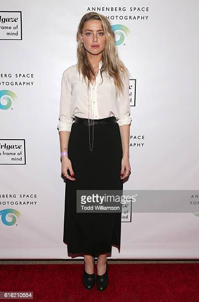 Amber Heard attends the opening of #girlgaze a frame of mind at Annenberg Space for Photography Skylight Studios on October 21 2016 in Los Angeles...