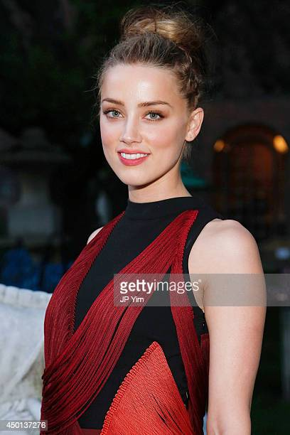 Amber Heard attends the Stella McCartney Spring 2015 Presentation at Elizabeth Street Gardens on June 5 2014 in New York City
