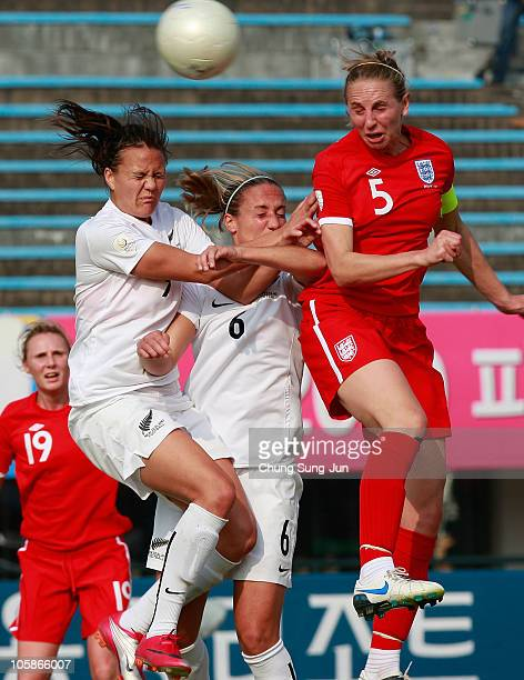 Amber Hearn and Rebbeca Smith of New Zealand compete for the ball in the air with Faye White of England during the Peace Queen Cup match between...