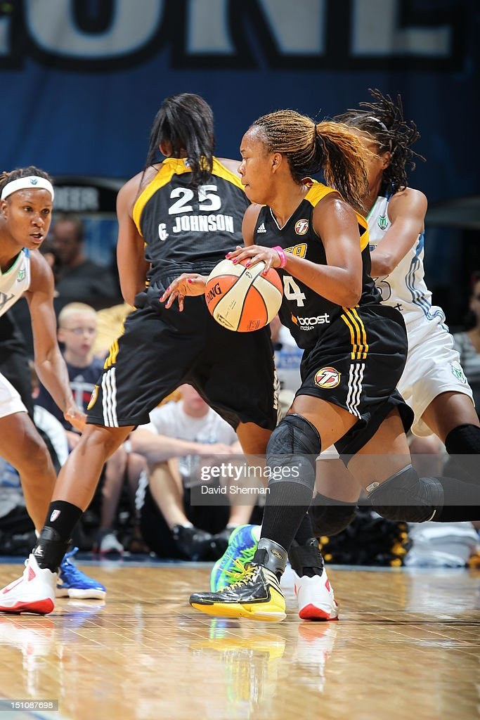 Amber Holt #4 of the Tulsa Shock dribbles the ball against Seimone Augustus #33 of the Minnesota Lynx during the WNBA game on August 31, 2012 at Target Center in Minneapolis, Minnesota.