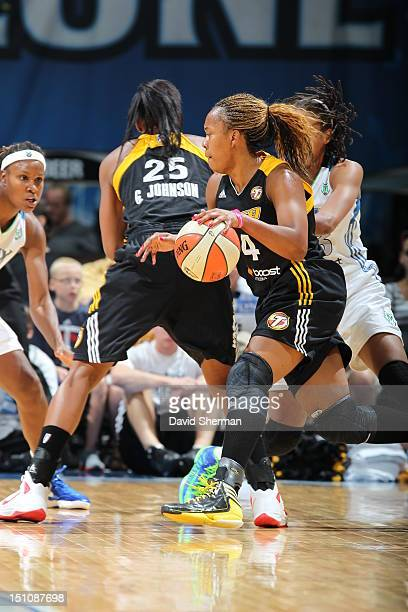 Amber Holt of the Tulsa Shock dribbles the ball against Seimone Augustus of the Minnesota Lynx during the WNBA game on August 31 2012 at Target...