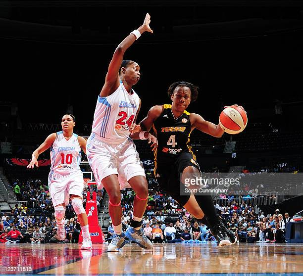 Amber Holt of the Tulsa Shock drives against Sandora Irvin of the Atlanta Dream at Philips Arena on September 4 2011 in Atlanta Georgia NOTE TO USER...