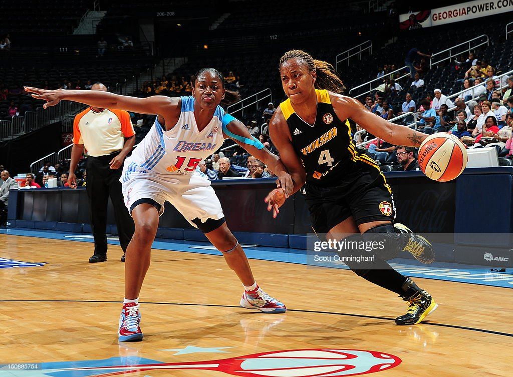 Amber Holt #4 of the Tulsa Shock drives against Tiffany Hayes #15 of the Atlanta Dream at Philips Arena on August 28, 2012 in Atlanta, Georgia.