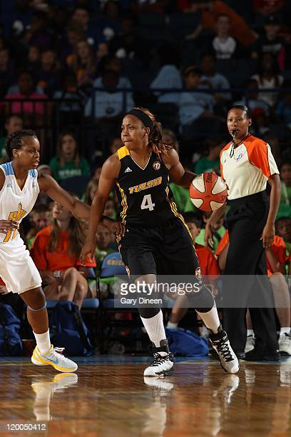 Amber Holt of the Tulsa Shock drives the ball against Epiphanny Prince of the Chicago Sky on July 13 2011 at the AllState Arena in Rosemont Illinois...