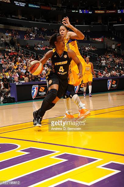 Amber Holt of the Tulsa Shock drives to the basket against the Los Angeles Sparks at Staples Center on August 26 2011 in Los Angeles California NOTE...