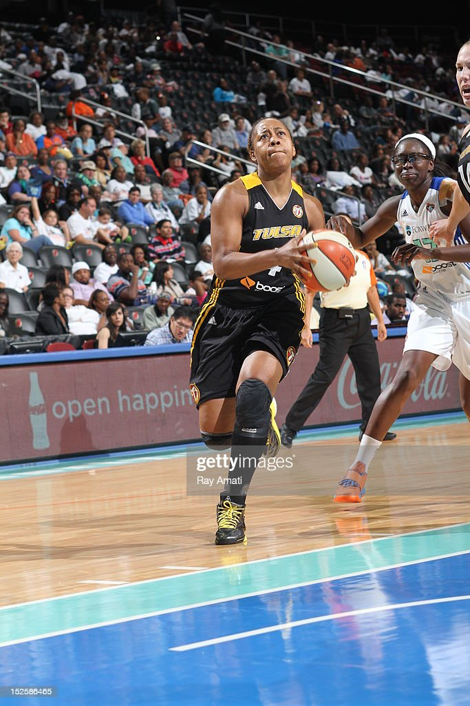 Amber Holt #4 of the Tulsa Shock drives to the basket on September 22, 2012 at the Prudential Center in Newark, New Jersey.