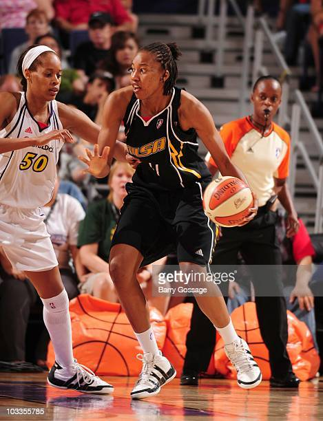 Amber Holt of the Tulsa Shock handles the ball against Tangela Smith of the Phoenix Mercury during a WNBA game on July 17 2010 at US Airways Center...