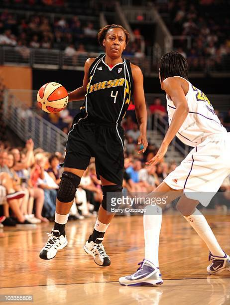 Amber Holt of the Tulsa Shock handles the ball during a WNBA game against the Phoenix Mercury on July 17 2010 at US Airways Center in Phoenix Arizona...