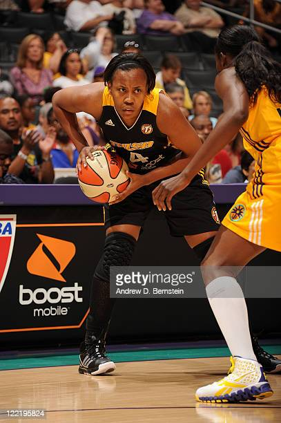 Amber Holt of the Tulsa Shock holds the ball in a game against the Los Angeles Sparks at Staples Center on August 26 2011 in Los Angeles California...